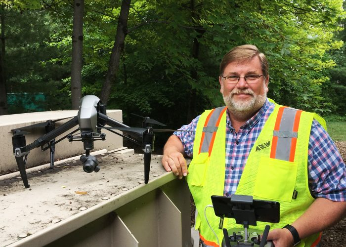 Craig Amey, PS, Senior Project Surveyor at AEW, and the firm's DJI Inspire 2 Drone.