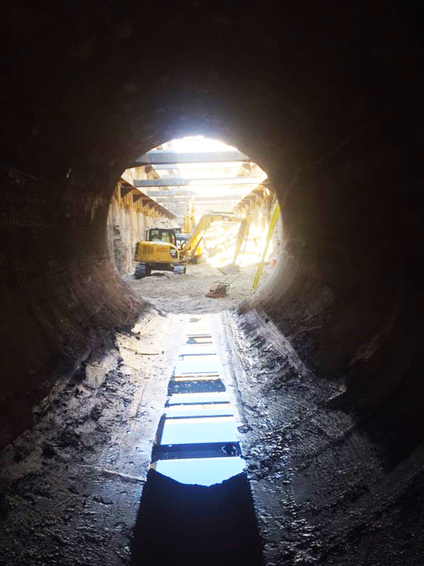 View of work activity in the recovery shaft from inside the eastern end of 11-foot  diameter interceptor.