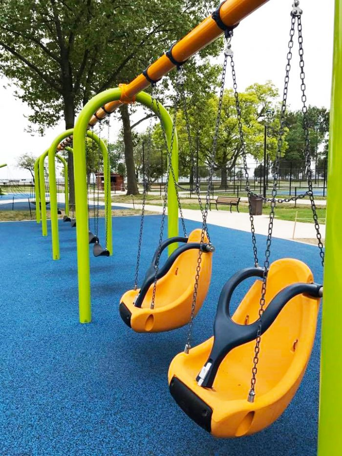 "ADA compliant ""bucket swings"" help to make it safe and enjoyable for all children to enjoy a swing ride."