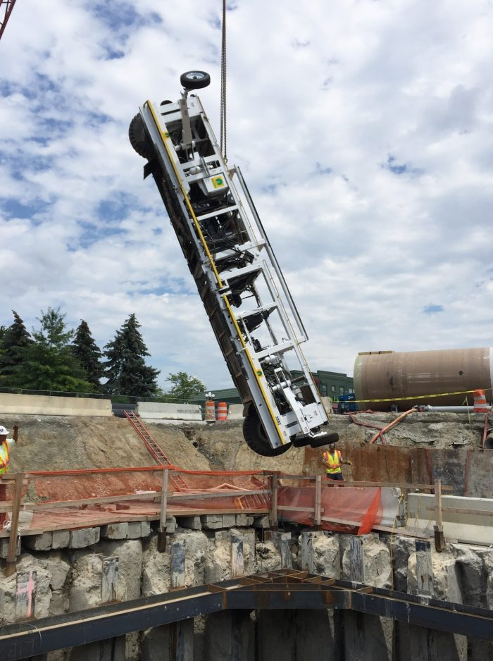 "The Jay Dee Contractor's ""Batmobile"" HOBAS pipe installing machine is lowered into the recovery shaft."