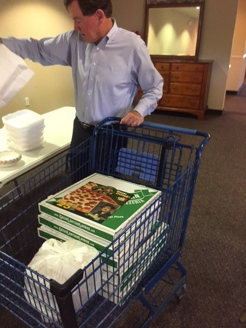Supervisor Cannon helped to set up and serve the pizza and salad luncheon.