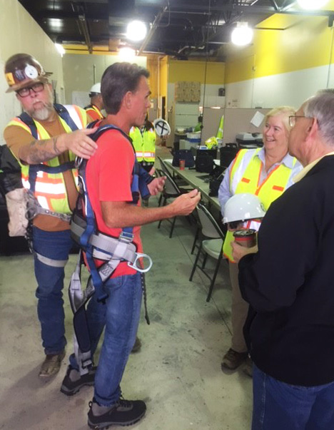 AEW's Lead Inspector Keith Lumma adjusts County Executive Mark Hackel's safety harness as he chats with Public Works Commissioner Candice Miller and Public Information Officer John Cwikla prior to descending into the recovery shaft for a first-hand tour of the repair efforts.