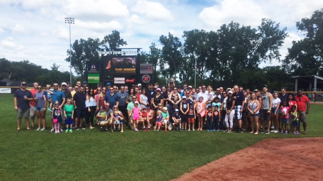 AEW employees, family and friends group photo at Jimmy John's Field