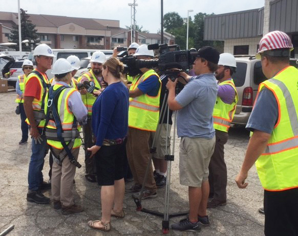 Commissioner Miller and Executive Hackel address the media following their visit to the bottom of the recovery shaft.