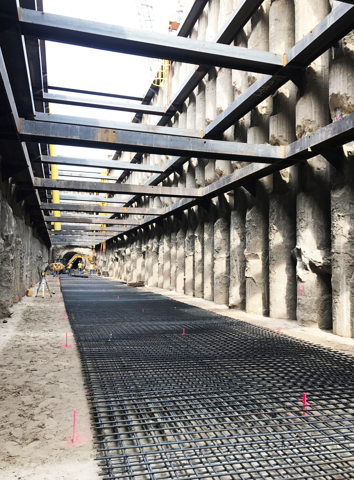 "A reinforced steel, or ""Re-Steel,"" mud mat is being placed prior to pouring the concrete base slab that the HOBAS pipe will be placed on at the bottom of the recovery shaft."