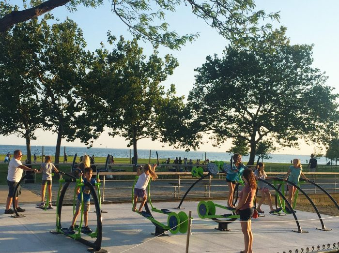The adult fitness equipment, being demonstrated here by children who were in attendance during the Ribbon Cutting ceremonies, is designed to promote adult fitness during cardiovascular activities while also enjoying a view of Lake St. Clair.