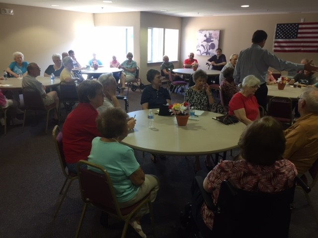 A substantial number of residents attended the meeting in the community room of the Villages apartment community.