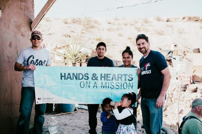 "Kyle, right, pictured with another volunteer, and a local family who was thrilled to be able to move into their new home provided by Kyle and his team along with the ""Casas Por Christo"" organization."