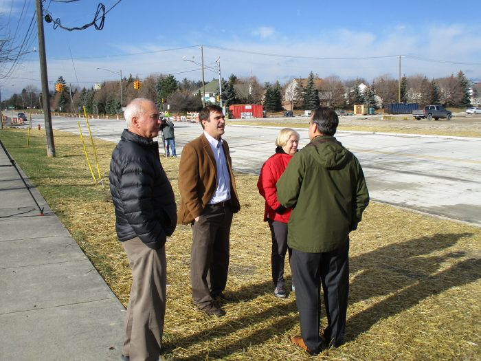 AEW Board Chairman Roy Rose, Executive VP Scott Lockwood, Commissioner Miller, and FKE Engineering President Fritz Klinger observed the re-opening of 15 Mile and much to the delight of motorists, homeowners and business owners, the flow of traffic once-again began to travel on the busy roadway.