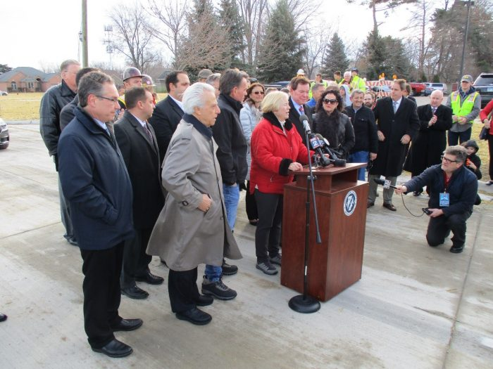 A number of elected officials, contractors, and citizens were on hand for the long-awaited re-opening of 15 Mile, and the completion of repairs to the formerly collapsed interceptor.