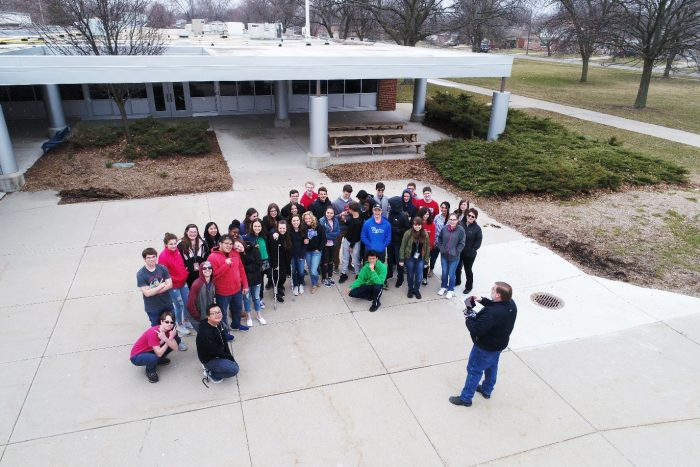 "Craig Amey, PS, AEW Senior Project Surveyor, and licensed FAA Remote Pilot, demonstrates the firm's ""Inspire 2 UAV"" for two classes at the Macomb Mathematics Science Technology Center (MMSTC) in Warren."