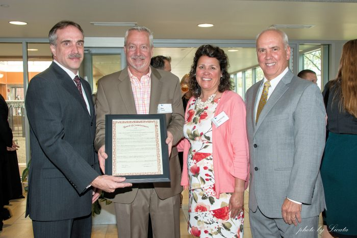 Macomb County Board of Commissioners Official Tribute AEW's Jeff Allegoet, County Commissioner Jim Carabelli (also presenting for fellow Commissioners), his wife, Annemarie, and Roy Rose.