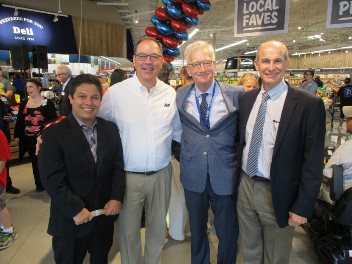 Juli, Lyle and Steve with Hank Meijer, representing the Meijer family at the Grand Opening Celebration.