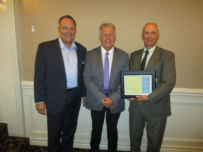 Center Line Mayor Bob Binson, Southeast Michigan Chamber of Commerce President John Johson, and AEW's Chairman of the Board Roy Rose.