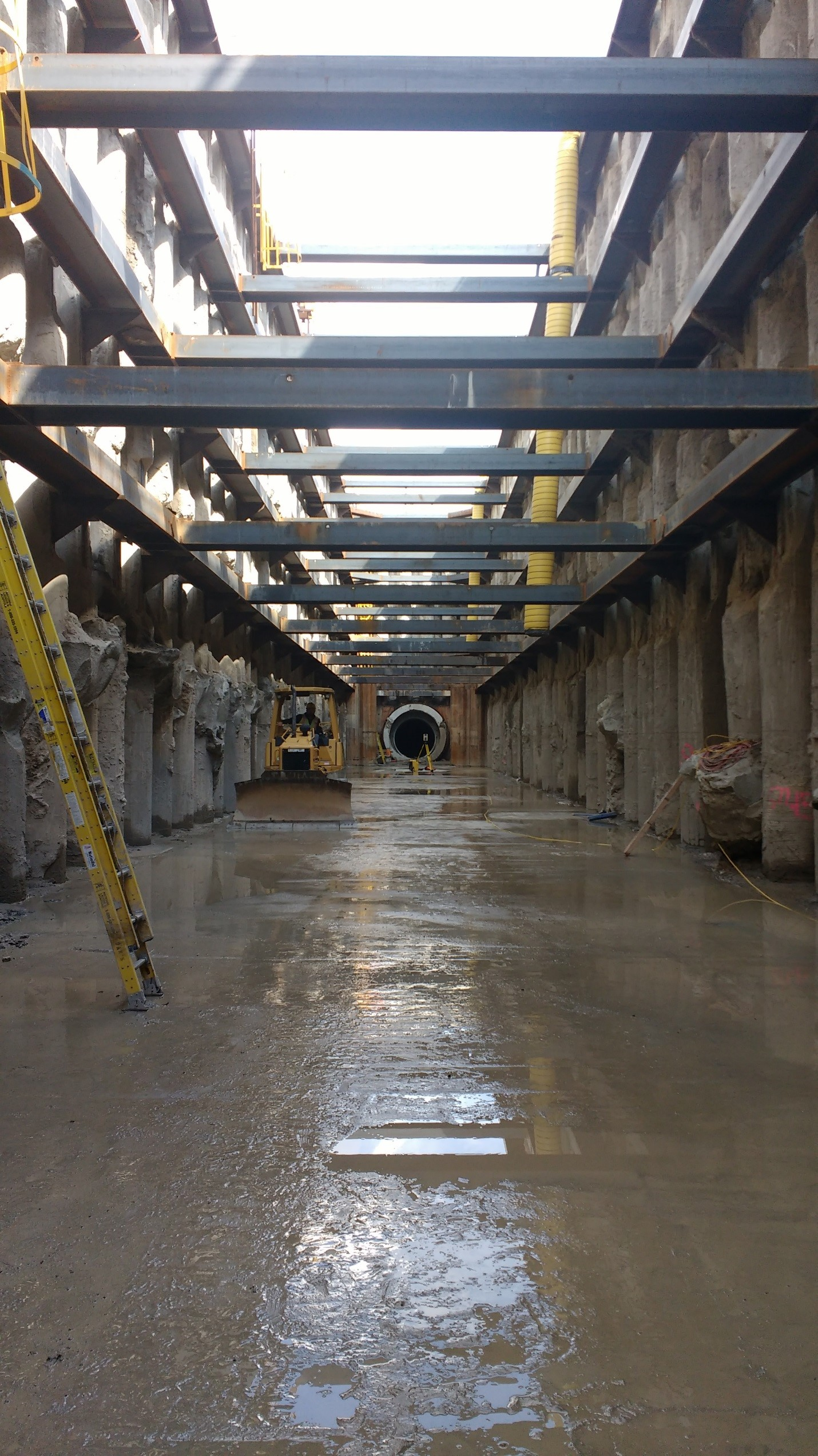 The bottom of the 300 ft. long recovery shaft, looking east with the 11 ft. diameter pipe at the end of the shaft.