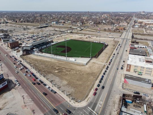 """Aerial view of the corner of Michigan and Trumbull in Detroit, the site of """"The Corner,"""" a $30-million mixed-use project that will fill in the final piece of the old Tiger Stadium site. (Photo: Larson Realty Group)"""